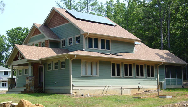 Craftsman style passive solar cottage with 4 bedrooms for Building houses with side views